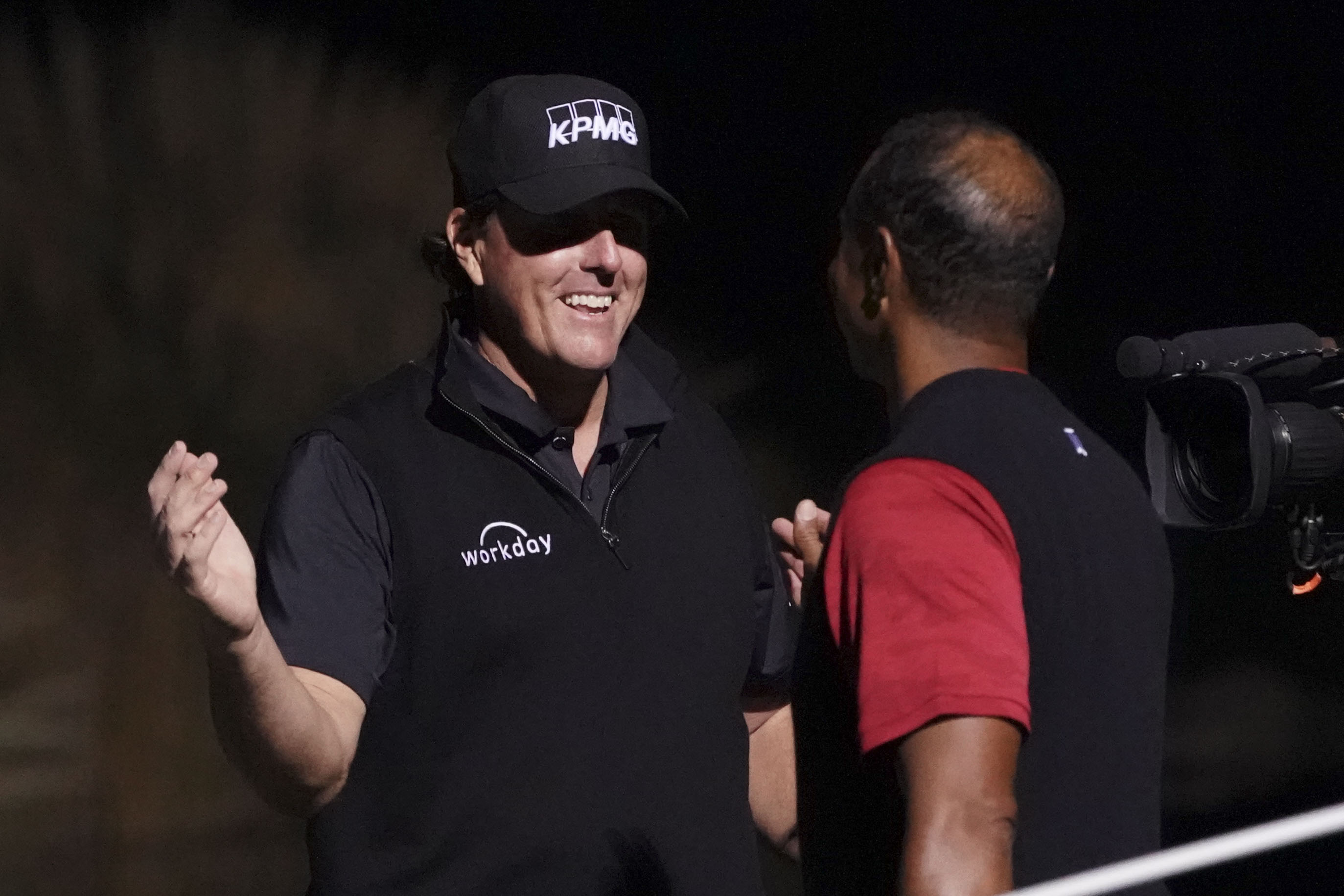 Nov 23, 2018; Las Vegas, NV, USA; Phil Mickelson (left) shakes hands with Tiger Woods (right) after The Match: Tiger vs Phil golf match at Shadow Creek Golf Course. Mandatory Credit: Kyle Terada-USA TODAY Sports