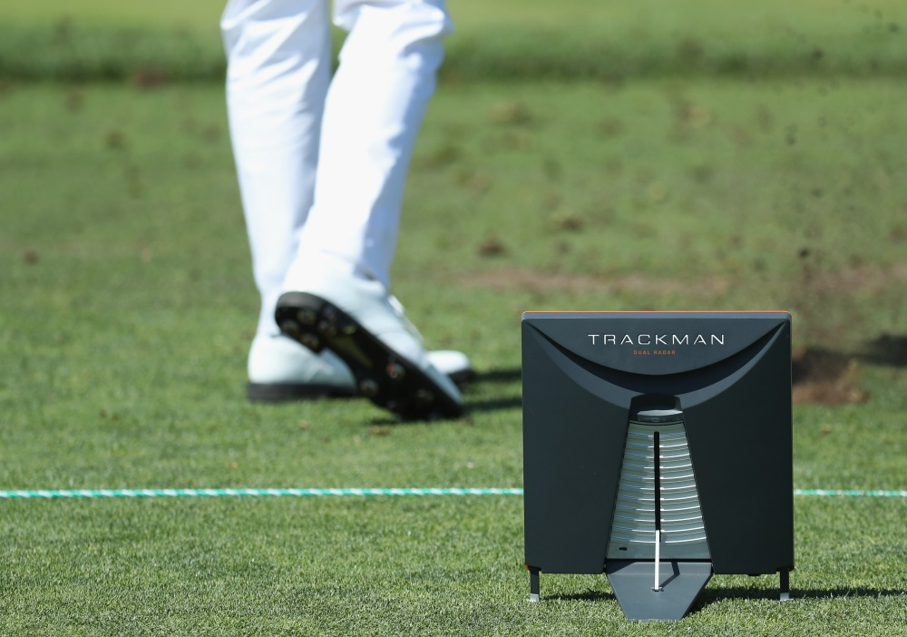SOUTHAMPTON, NY - JUNE 12: A trackman is seen as Justin Thomas of the United States plays a shot on the range during a practice round prior to the 2018 U.S. Open at Shinnecock Hills Golf Club on June 12, 2018 in Southampton, New York. (Photo by Rob Carr/Getty Images)