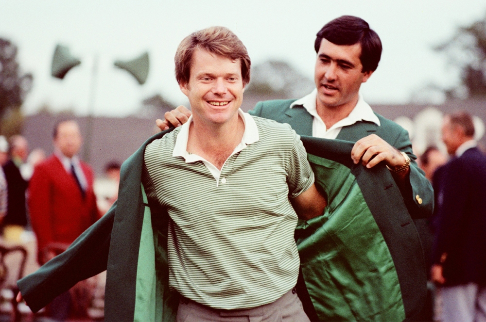 Tom Watson Puts On The Green Jacket With The Help Of Seve Ballesteros At The Presentation Ceremony Of The 1981 Masters Tournament (Photo by Augusta National/Getty Images)
