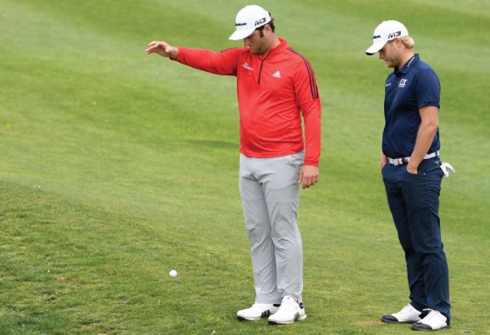 New Golf Rules 2019 Henric Sturehed watches Jon Rahm take a drop at the Spanish Open. Under the new rules, players will drop from knee height instead of shoulder height.