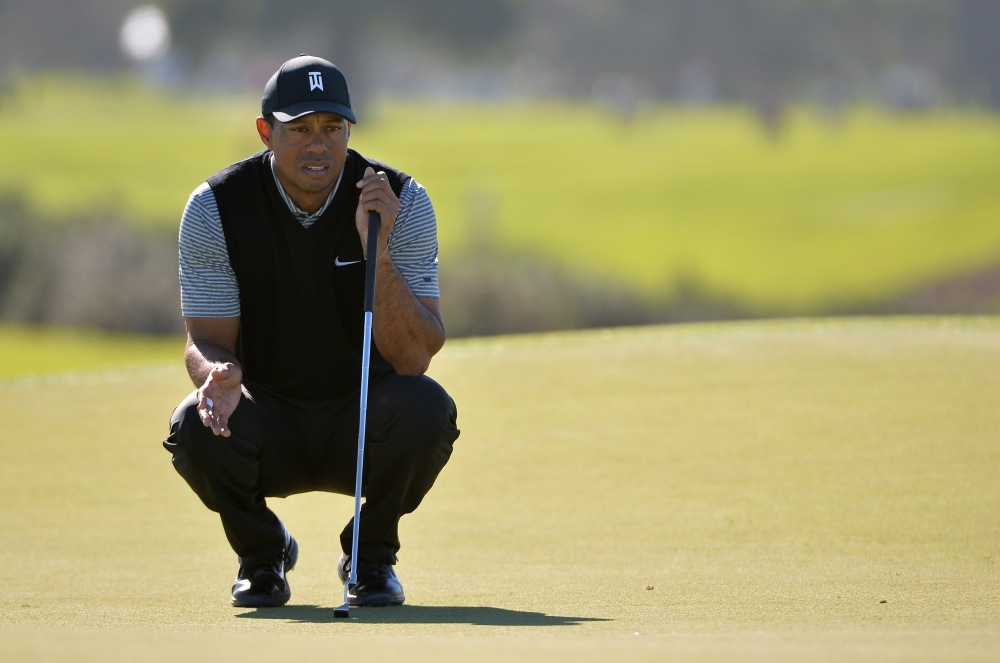 Jan 25, 2019; San Diego, CA, USA; Tiger Woods lines up a putt on the 13th green during the second round of the Farmers Insurance Open golf tournament at Torrey Pines Municipal Golf Course - South Course. Mandatory Credit: Orlando Ramirez-USA TODAY Sports