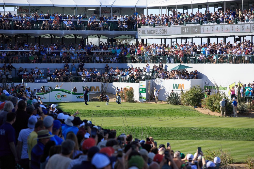 Feb 4, 2018; Scottsdale, AZ, USA; Phil Mickelson with his tee shot on the par 3 16th hole during the final round of the Waste Management Phoenix Open golf tournament at TPC Scottsdale. Mandatory Credit: Allan Henry-USA TODAY Sports