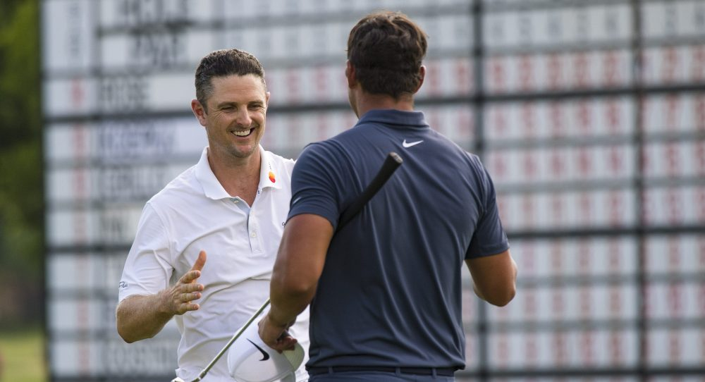 May 27, 2018; Fort Worth, TX, USA; Justin Rose (left) shakes hands with Brooks Koepka (right) after they finish their final hole of the Fort Worth Invitational golf tournament at Colonial Country Club. Mandatory Credit: Jerome Miron-USA TODAY Sports