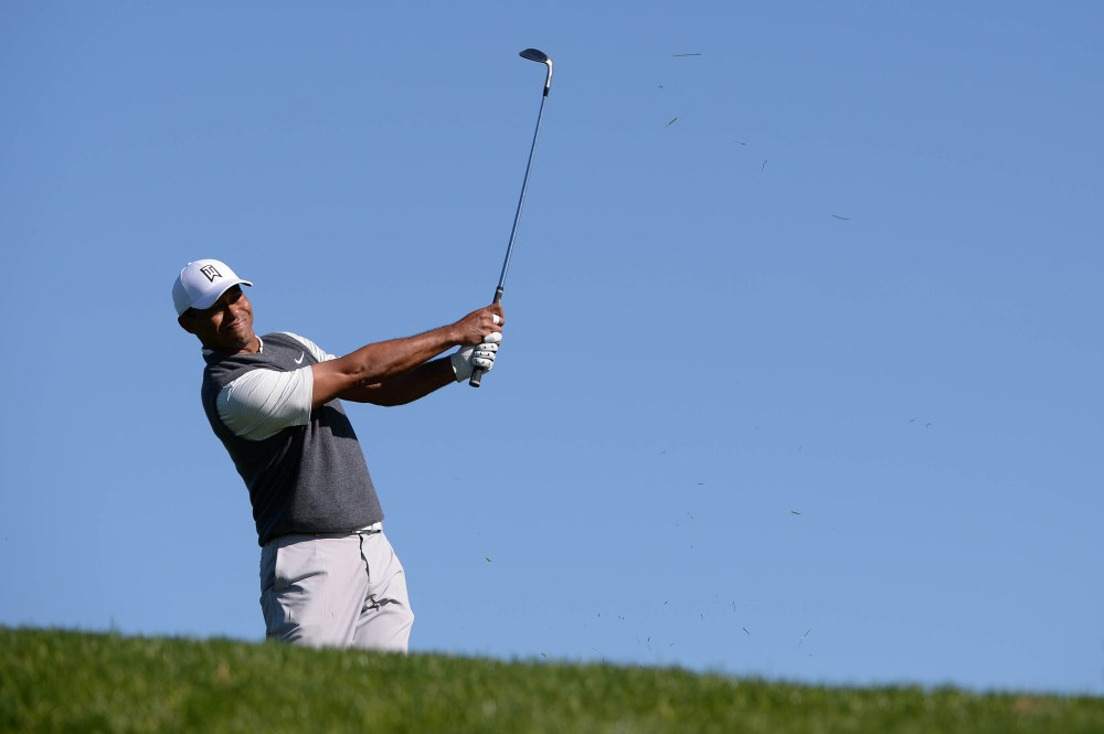 Jan 24, 2019; San Diego, CA, USA; Tiger Woods plays his second shot on the second hole during the first round of the Farmers Insurance Open golf tournament at Torrey Pines Municipal Golf Course - South Co. Mandatory Credit: Orlando Ramirez-USA TODAY Sports