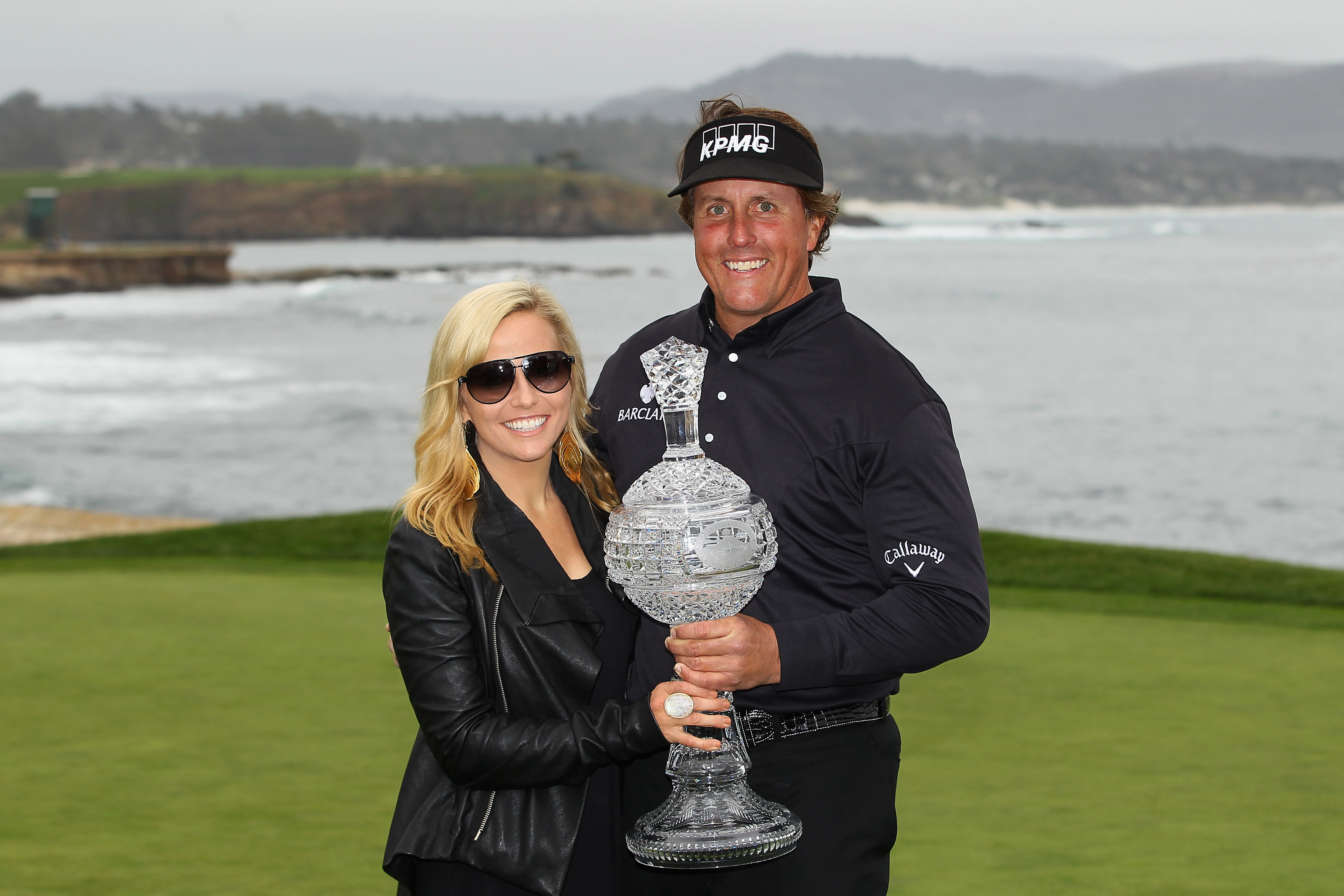 PEBBLE BEACH, CA - FEBRUARY 12: Phil Mickelson (R) celebrates with his wife Amy (L) while holding the tournament trophy after winning with an eight-under-par 64 during the AT&T Pebble Beach National Pro-Am at Pebble Beach Golf Links on February 12, 2012 in Pebble Beach, California. (Photo by Ezra Shaw/Getty Images)
