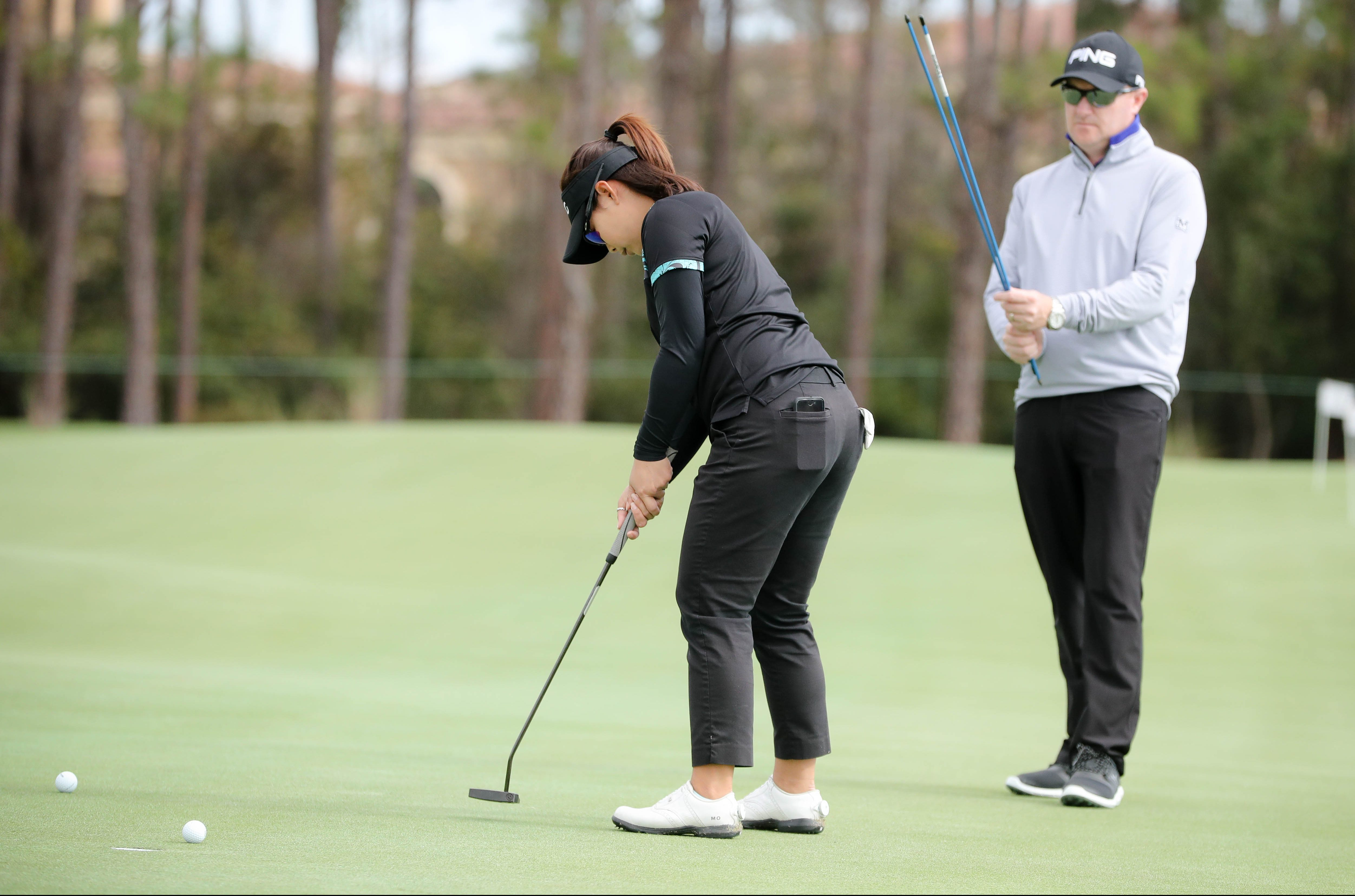 Jan 14, 2019;Lake Buena Vista, FL, USA; Putting coach Gareth Raflewski and LPGA players Ariya and Moriya Jutanugarn during the LPGA Diamond Resorts TOC at Tranquilo GC at Four Seasons.