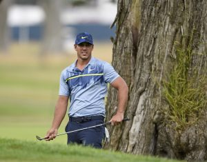 Brooks Koepka watches after playing his shot from the rough on the 2nd hole during the final round of the 2020 PGA Championship golf tournament at TPC Harding Park.