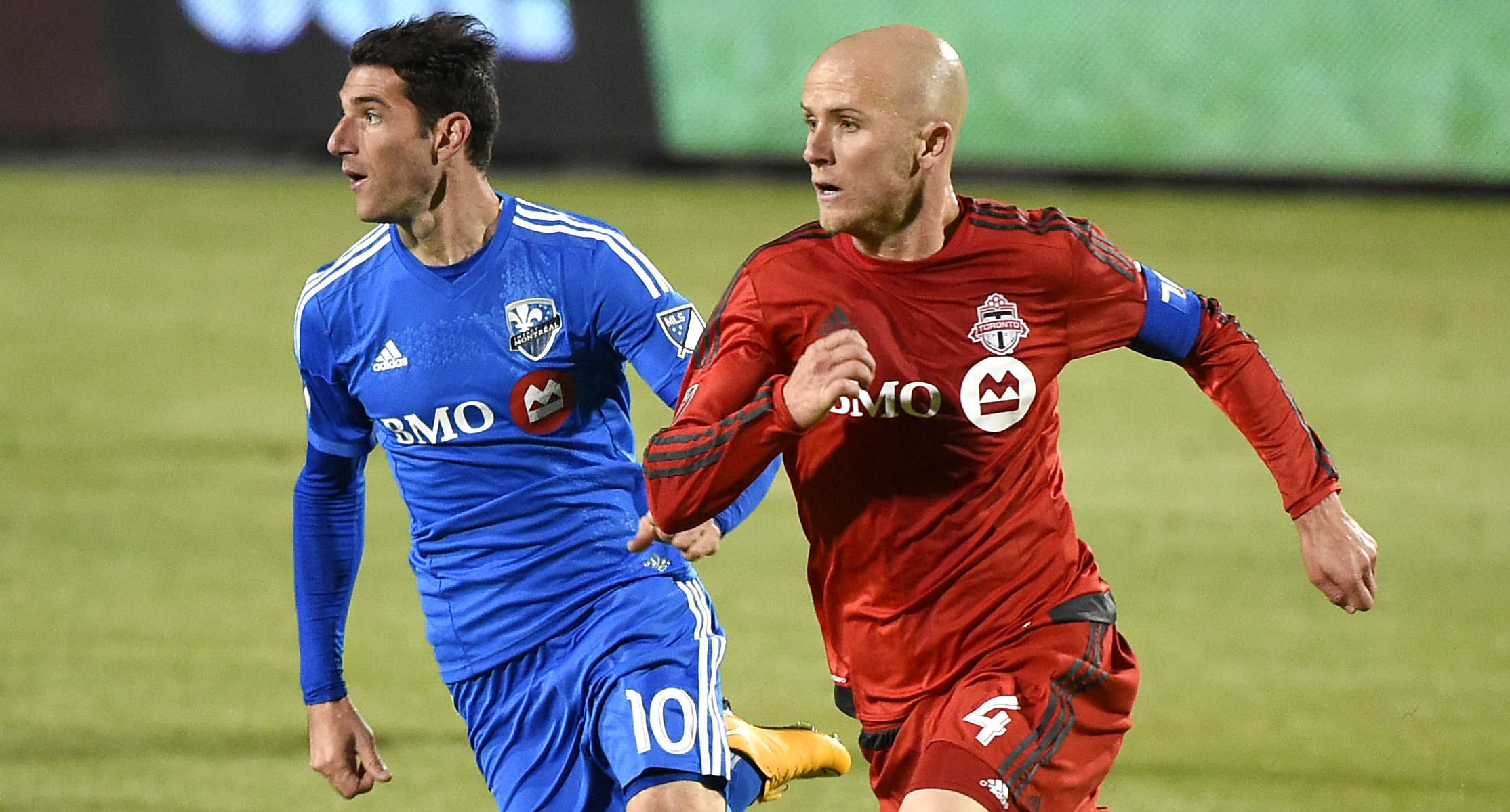 May 13, 2015; Toronto, Ontario, Canada; Toronto FC midfielder Michael Bradley (4) moves the ball past Montreal Impact midfielder Ignacio Piatti (10) during the second half of an Amway Canadian Championship game at BMO Field. Toronto won 3-2 but Montreal advances on aggregate score. Mandatory Credit: Dan Hamilton-USA TODAY Sports