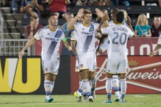 Aug 1, 2015; Commerce City, CO, USA; Los Angeles Galaxy midfielder Steven Gerrard (8) and defender A.J. DeLaGarza (20) celebrate the goal of forward Robbie Keane (7) in the second half against the Colorado Rapids at Dick's Sporting Goods Park. Mandatory Credit: Isaiah J. Downing-USA TODAY Sports