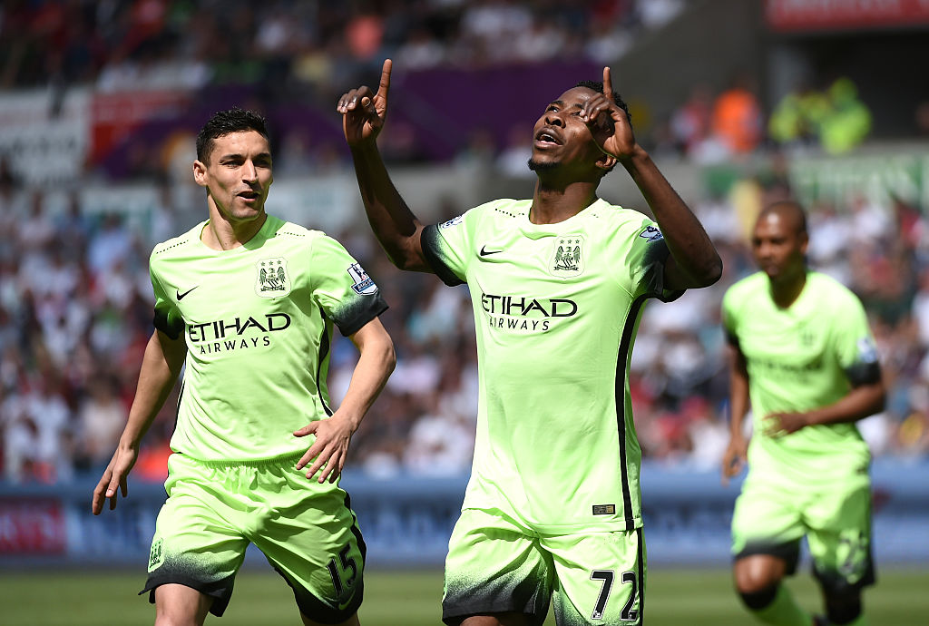 SWANSEA, WALES - MAY 15: Kelechi Iheanacho of Manchester City celebrates scoring his team's first goal during the Barclays Premier League match between Swansea City and Manchester City at the Liberty Stadium on May 15, 2016 in Swansea, Wales.