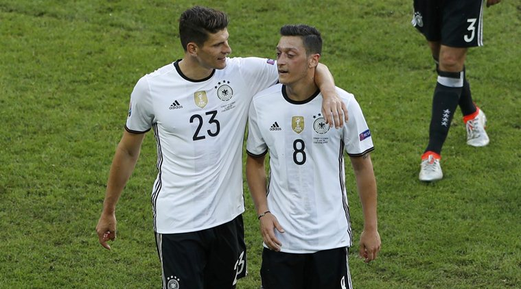 Football Soccer - Germany v Slovakia - EURO 2016 - Round of 16 - Stade Pierre Mauroy - Lille, France - 26/6/16 Germany's Mario Gomez and Mesut Ozil after the match   REUTERS/Benoit Tessier