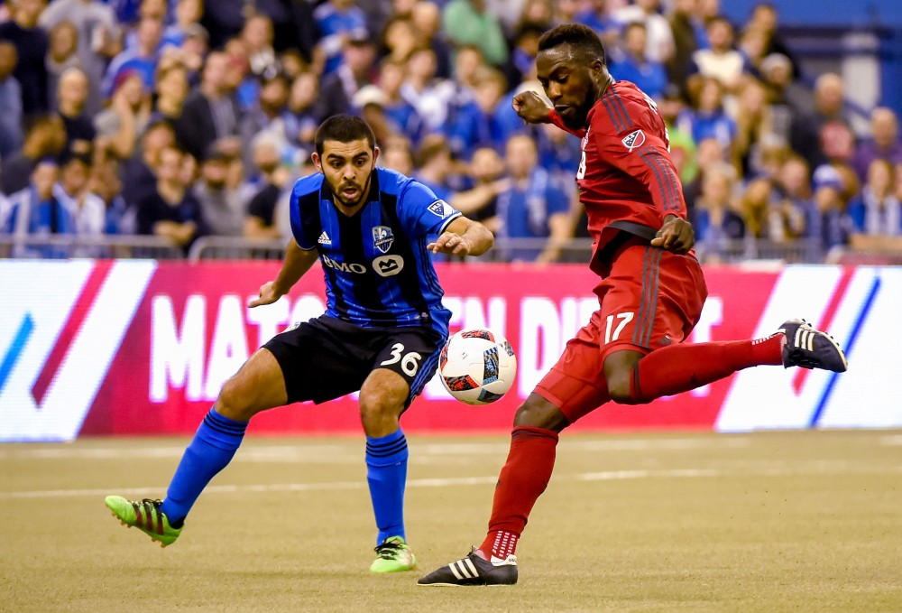 Toronto FC forward Jozy Altidore (17) takes a shot past Montreal Impact defender Victor Cabrera (36) in the first leg of the MLS Eastern Conference Championship at Olympic Stadium. Montreal won 3-2. Credit: Dan Hamilton-USA TODAY Sports