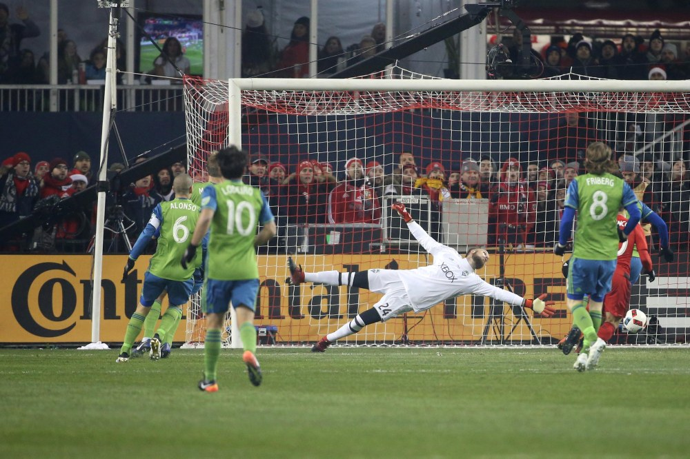 Dec 10, 2016; Toronto, Canada; Seattle Sounders goalkeeper Stefan Frei (24) jumps at a shot on goal during the first half against the Toronto FC in the 2016 MLS Cup at BMO Field. Mandatory Credit: Geoff Burke-USA TODAY Sports