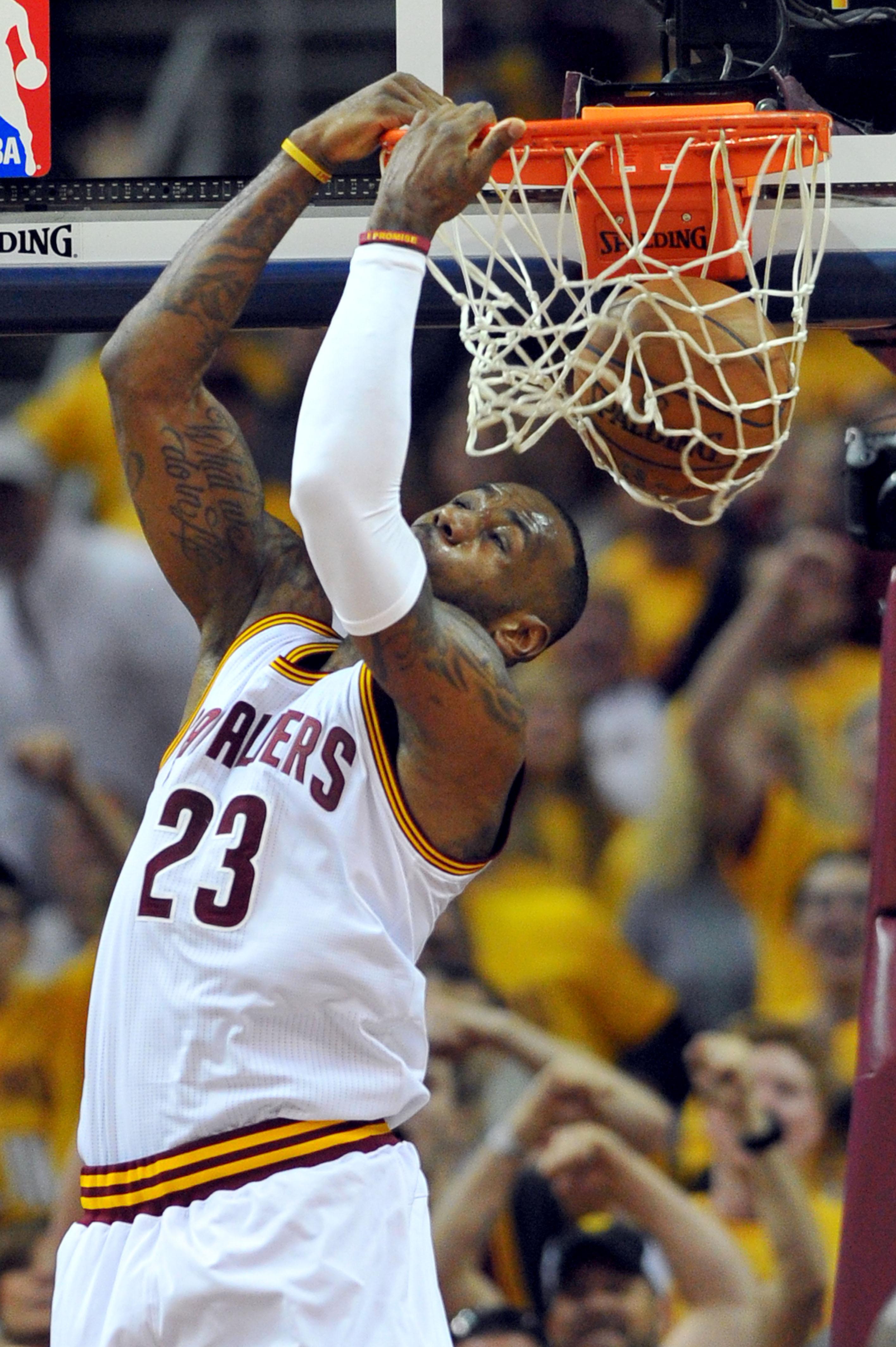 LeBron James goes sky high for two-handed reverse slam ...