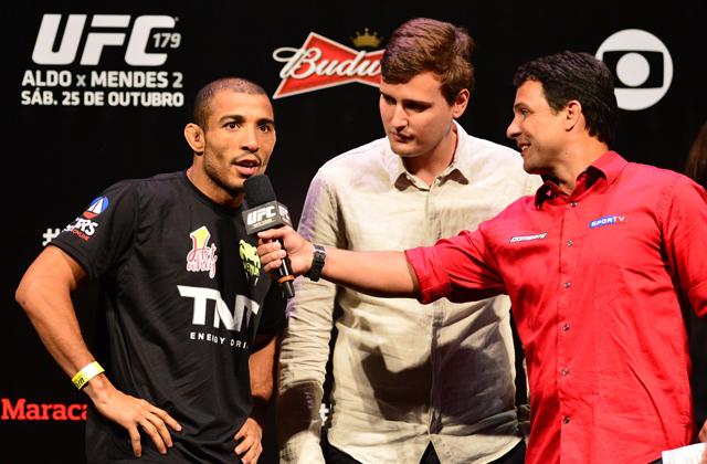 Jose Aldo (left) and Derek Kronig (center)