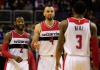 WASHINGTON, DC - DECEMBER 16: John Wall #2, Marcin Gortat #4, and Bradley Beal #3 of the Washington Wizards celebrate during the closing mintues of the Wizards 109-95 win over the Minnesota Timberwolves at Verizon Center on December 16, 2014 in Washington, DC. NOTE TO USER: User expressly acknowledges and agrees that, by downloading and or using this photograph, User is consenting to the terms and conditions of the Getty Images License Agreement (Photo by Rob Carr/Getty Images)