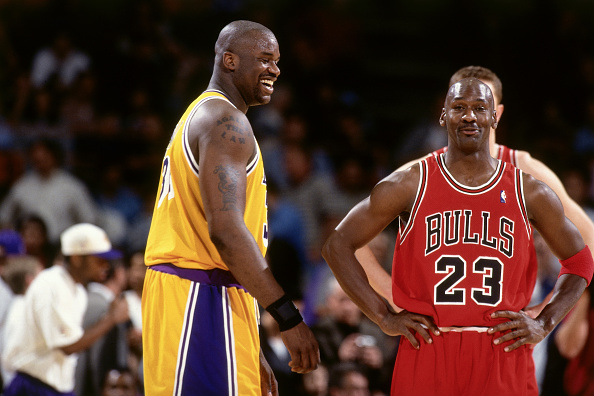 INGLEWOOD, CA - FEBRUARY 1: Shaquille O'Neal #34 of the Los Angeles Lakers jokes with Michael Jordan #23 of the Chicago Bulls on February 1, 1998 at The Forum in Inglewood, California. NOTE TO USER: User expressly acknowledges and agrees that, by downloading and/or using this Photograph, user is consenting to the terms and conditions of the Getty Images License Agreement. Mandatory Copyright Notice: Copyright 1998 NBAE (Photo by Andrew D. Bernstein/NBAE via Getty Images)