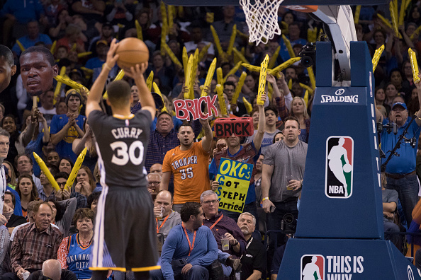 OKLAHOMA CITY, OK - FEBRUARY 27: Oklahoma City Thunder fans try to distract Stephen Curry #30 of the Golden State Warriors as he shoots a free throw during the third period of a NBA game at the Chesapeake Energy Arena on February 27, 2016 in Oklahoma City, Oklahoma. The Warriors won 121-118 in overtime. NOTE TO USER: User expressly acknowledges and agrees that, by downloading and or using this photograph, User is consenting to the terms and conditions of the Getty Images License Agreement. (Photo by J Pat Carter/Getty Images)