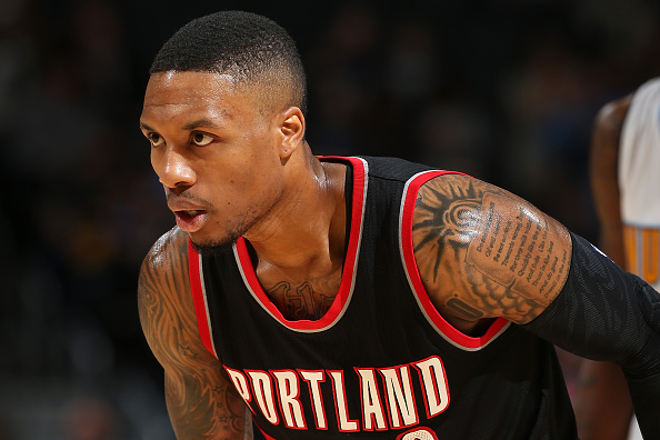 DENVER, CO - NOVEMBER 09: Damian Lillard #0 of the Portland Trail Blazers faces the Denver Nuggets at Pepsi Center on November 9, 2015 in Denver, Colorado. NOTE TO USER: User expressly acknowledges and agrees that, by downloading and or using this photograph, User is consenting to the terms and conditions of the Getty Images License Agreement. (Photo by Doug Pensinger/Getty Images)