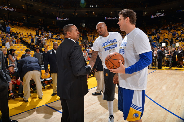 OAKLAND,CA - JUNE 4: Head coach of the Los Angeles Clippers, Mark Jackson speaks to Luke Walton, assistant coach of the Golden State Warriors at the Oracle Arena during Game one of the 2015 NBA Finals on June 4, 2015 in Oakland,California NOTE TO USER: User expressly acknowledges and agrees that, by downloading and/or using this Photograph, user is consenting to the terms and conditions of the Getty Images License Agreement. Mandatory Copyright Notice: Copyright 2015 NBAE (Photo by Jesse D. Garrabrant/NBAE via Getty Images)