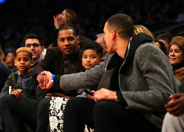 TORONTO, ON - FEBRUARY 12: 2016 NBA All Star Carmelo Anthony of the New York Knicks and 2016 NBA Slam Dunk participant Aaron Gordon of the Orlando Magic speak on the sideline in the second half between the United States team and World team during the BBVA Compass Rising Stars Challenge 2016 at Air Canada Centre on February 12, 2016 in Toronto, Canada. NOTE TO USER: User expressly acknowledges and agrees that, by downloading and/or using this Photograph, user is consenting to the terms and conditions of the Getty Images License Agreement. (Photo by Elsa/Getty Images)
