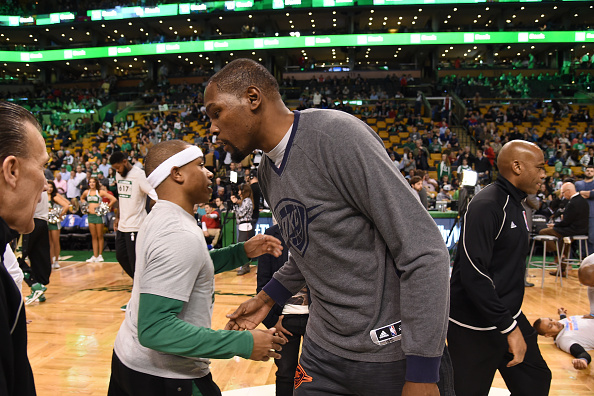 BOSTON, MA - MARCH 16: Isaiah Thomas #4 of the Boston Celtics and Kevin Durant #35 of the Oklahoma City Thunder are seen before the game on March 16, 2016 at the TD Garden in Boston, Massachusetts. NOTE TO USER: User expressly acknowledges and agrees that, by downloading and or using this photograph, User is consenting to the terms and conditions of the Getty Images License Agreement. Mandatory Copyright Notice: Copyright 2016 NBAE (Photo by Brian Babineau/NBAE via Getty Images)