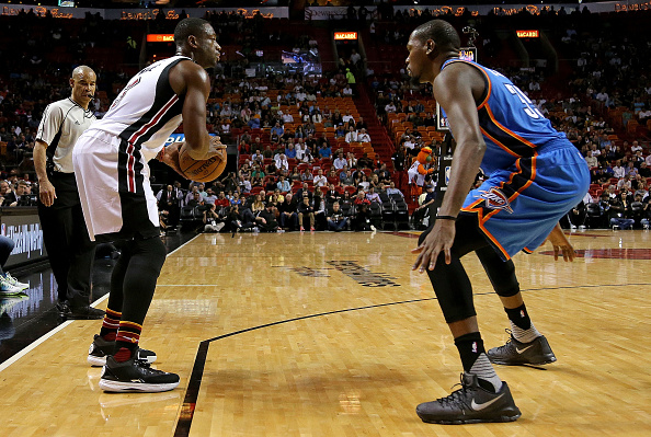MIAMI, FL - DECEMBER 03: Dwyane Wade #3 of the Miami Heat drives on Kevin Durant #35 of the Oklahoma City Thunder during a game at American Airlines Arena on December 3, 2015 in Miami, Florida. NOTE TO USER: User expressly acknowledges and agrees that, by downloading and/or using this photograph, user is consenting to the terms and conditions of the Getty Images License Agreement. Mandatory copyright notice: (Photo by Mike Ehrmann/Getty Images)