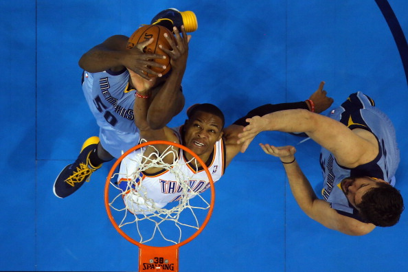 OKLAHOMA CITY, OK - APRIL 29: Russell Westbrook #0 of the Oklahoma City Thunder jumps for the rebound with Zach Randolph #50 and Marc Gasol #33 of the Memphis Grizzlies in Game Five of the Western Conference Quarterfinals during the 2014 NBA Playoffs at Chesapeake Energy Arena on April 29, 2014 in Oklahoma City, Oklahoma. NOTE TO USER: User expressly acknowledges and agrees that, by downloading and or using this photograph, User is consenting to the terms and conditions of the Getty Images License Agreement. (Photo by Ronald Martinez/Getty Images)