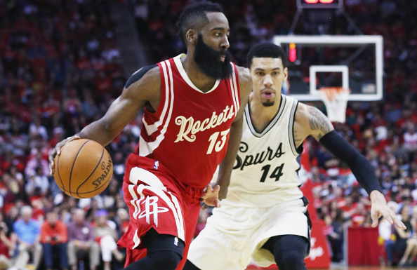 HOUSTON, TX - DECEMBER 25: James Harden #13 of the Houston Rockets drives with the basketball against Danny Green #14 of the San Antonio Spurs during their game at the Toyota Center on December 25, 2015 in Houston, Texas. NOTE TO USER: User expressly acknowledges and agrees that, by downloading and or using this Photograph, user is consenting to the terms and conditions of the Getty Images License Agreement. (Photo by Scott Halleran/Getty Images)