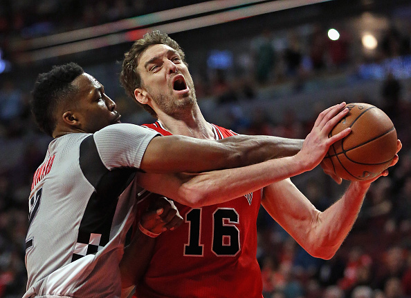 CHICAGO, IL - MARCH 05: Dwight Howard #12 of the Houston Rockets fouls Pau Gasol #16 of the Chicago Bulls at the United Center on March 5, 2016 in Chicago, Illinois. The Bulls defeated the Rockets 108-100. NOTE TO USER: User expressly acknowledges and agrees that, by downloading and or using the photograph, User is consenting to the terms and conditions of the Getty Images License Agreement. (Photo by Jonathan Daniel/Getty Images)
