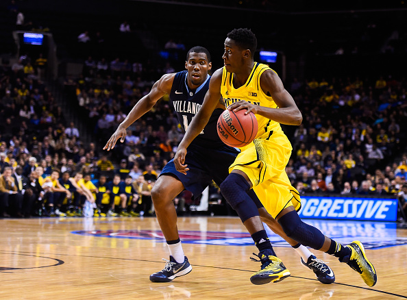 NEW YORK, NY - NOVEMBER 25: Caris LeVert #23 of the Michigan Wolverines dribbles past Darryl Reynolds #14 of the Villanova Wildcats in the first half at the Barclays Center on November 25, 2014 in the Brooklyn borough of New York City. (Photo by Alex Goodlett/Getty Images)