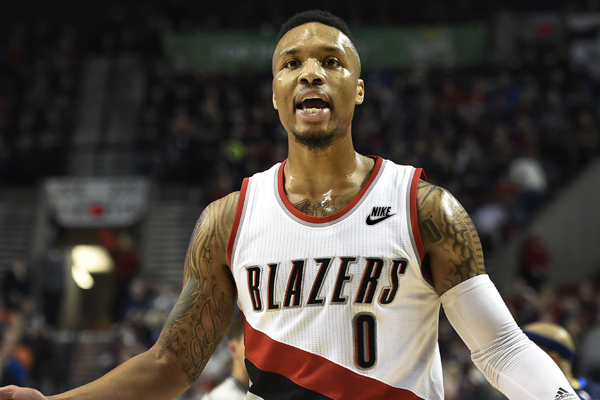 Mar 23, 2016; Portland, OR, USA; Portland Trail Blazers guard Damian Lillard (0) argues a call with an official during the first quarter of the game against the Dallas Mavericks at Moda Center at the Rose Quarter. Mandatory Credit: Steve Dykes-USA TODAY Sports