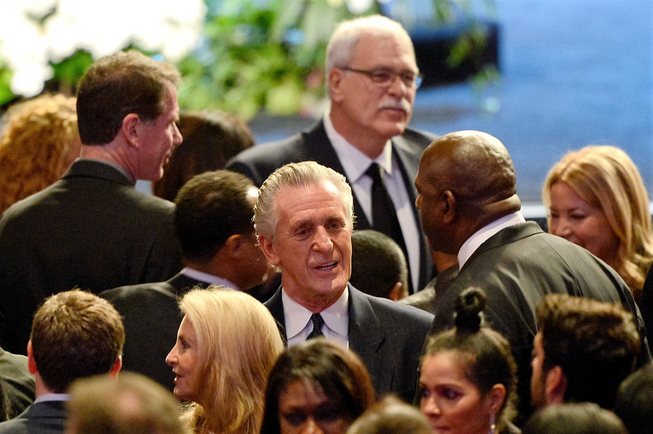 LOS ANGELES, CA - FEBRUARY 21: (C) Former Los Angeles Lakers head coach Pat Riley, (top) former head coach Phil Jackson and (R) Earvin 'Magic' Johnson are seen before the start of the memorial service for Los Angeles Lakers owner Dr. Jerry Buss at the Nokia Theatre L.A. Live on February 21, 2013 in Los Angeles, California. Dr. Buss died at the age of 80 on Monday following an 18-month battle with cancer. Buss won 10 NBA championships as Lakers owner since purchasing the team in 1979. (Photo by Kevork Djansezian/Getty Images)