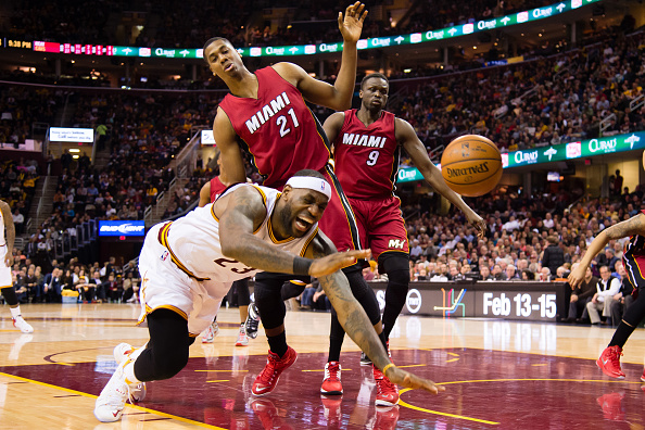 CLEVELAND, OH - FEBRUARY 11: LeBron James #23 of the Cleveland Cavaliers falls after colliding with Hassan Whiteside #21 of the Miami Heat during the second half at Quicken Loans Arena on February 11, 2015 in Cleveland, Ohio. The Cavaliers defeated the Heat 113-93. NOTE TO USER: User expressly acknowledges and agrees that, by downloading and or using this photograph, User is consenting to the terms and conditions of the Getty Images License Agreement. (Photo by Jason Miller/Getty Images)
