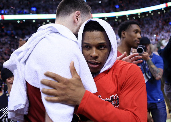 TORONTO, ON - MAY 15: Kyle Lowry #10 of the Toronto Raptors is congratulated by Josh McRoberts #4 of the Miami Heat following Game Seven of the Eastern Conference Quarterfinals during the 2016 NBA Playoffs at the Air Canada Centre on May 15, 2016 in Toronto, Ontario, Canada. NOTE TO USER: User expressly acknowledges and agrees that, by downloading and or using this photograph, User is consenting to the terms and conditions of the Getty Images License Agreement. (Photo by Vaughn Ridley/Getty Images)