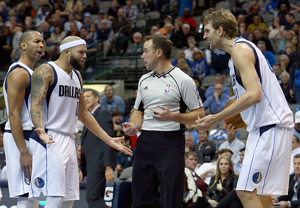 DALLAS, TX - DECEMBER 14: Devin Harris #34 of the Dallas Mavericks, Deron Williams #8 of the Dallas Mavericks and Dirk Nowitzki #41 of the Dallas Mavericks argue with referee Josh Tiven #58 after a call in favor of the Phoenix Suns in the second half at American Airlines Center on December 14, 2015 in Dallas, Texas. NOTE TO USER: User expressly acknowledges and agrees that, by downloading and or using this photograph, User is consenting to the terms and conditions of the Getty Images License Agreement. (Photo by Tom Pennington/Getty Images)