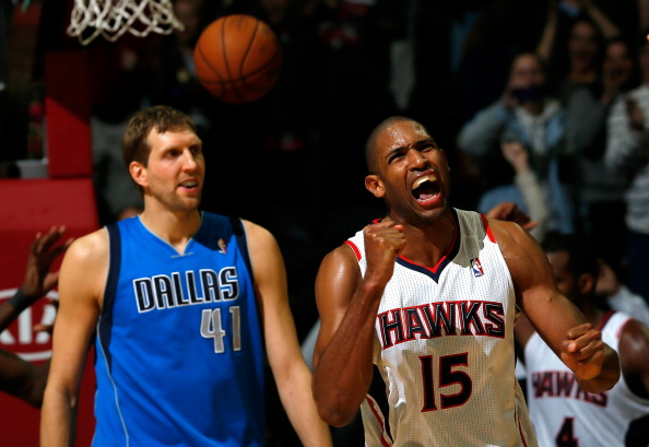 ATLANTA, GA - NOVEMBER 29: Al Horford #15 of the Atlanta Hawks celebrates their 88-87 win over Dirk Nowitzki #41 of the Dallas Mavericks at Philips Arena on November 29, 2013 in Atlanta, Georgia. NOTE TO USER: User expressly acknowledges and agrees that, by downloading and or using this photograph, User is consenting to the terms and conditions of the Getty Images License Agreement. (Photo by Kevin C. Cox/Getty Images)