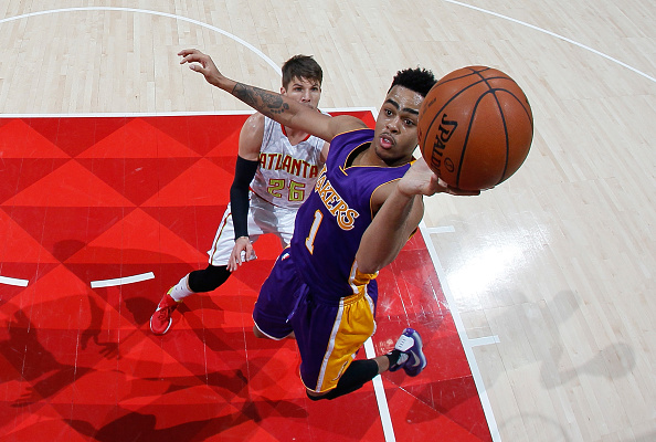 ATLANTA, GA - DECEMBER 04: D'Angelo Russell #1 of the Los Angeles Lakers shoots against Kyle Korver #26 of the Atlanta Hawks at Philips Arena on December 4, 2015 in Atlanta, Georgia. NOTE TO USER User expressly acknowledges and agrees that, by downloading and or using this photograph, user is consenting to the terms and conditions of the Getty Images License Agreement. (Photo by Kevin C. Cox/Getty Images)