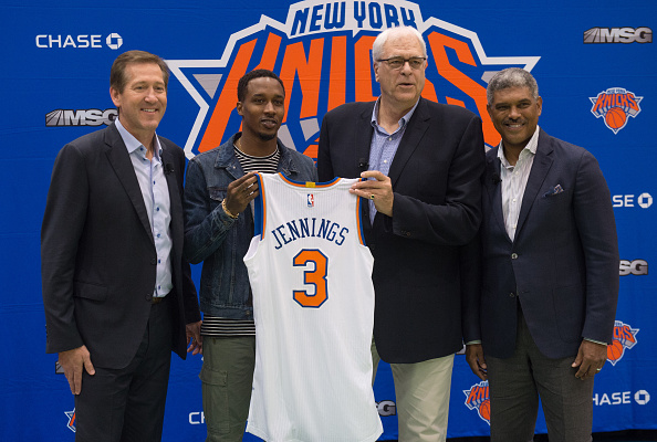 New York Knicks coach Jeff Hornacek, Knicks newest player Brandon Jennings, Knicks President Phil Jackson, and General Manager Steven Mills pose at the Madison Square Garden training center, on July 8, 2016 in Tarrytown, New York. / AFP / Bryan R. Smith (Photo credit should read BRYAN R. SMITH/AFP/Getty Images)