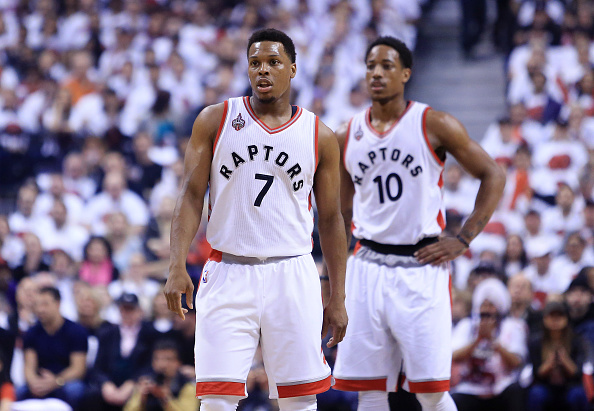 TORONTO, ON - MAY 15: Kyle Lowry #7 and DeMar DeRozan #10 of the Toronto Raptors look on in the first half of Game Seven of the Eastern Conference Quarterfinals against the Miami Heat during the 2016 NBA Playoffs at the Air Canada Centre on May 15, 2016 in Toronto, Ontario, Canada. NOTE TO USER: User expressly acknowledges and agrees that, by downloading and or using this photograph, User is consenting to the terms and conditions of the Getty Images License Agreement. (Photo by Vaughn Ridley/Getty Images)