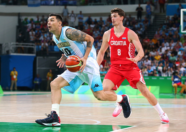 RIO DE JANEIRO, BRAZIL - AUGUST 09: Carlos Delfino #10 of Argentina moves the ball against Mario Hezonja #8 of Croatia during a preliminary round basketball game between Croatia and Argentina on Day 4 of the Rio 2016 Olympic Games at the Carioca Arena 1 on August 9, 2016 in Rio de Janeiro, Brazil. (Photo by Alex Livesey/Getty Images)