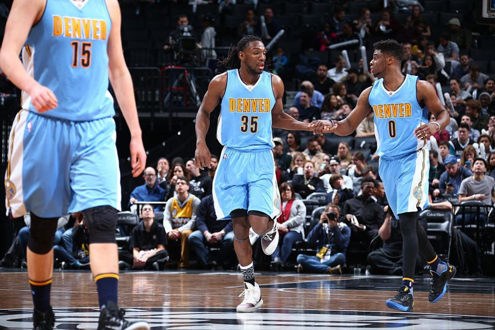 BROOKLYN, NY - FEBRUARY 8: Kenneth Faried #35 and Emmanuel Mudiay #0 of the Denver Nuggets high fives during the game against the Brooklyn Nets on February 8, 2016 at Barclays Center in Brooklyn, New York. NOTE TO USER: User expressly acknowledges and agrees that, by downloading and or using this Photograph, user is consenting to the terms and conditions of the Getty Images License Agreement. Mandatory Copyright Notice: Copyright 2016 NBAE (Photo by Nathaniel S. Butler/NBAE via Getty Images)
