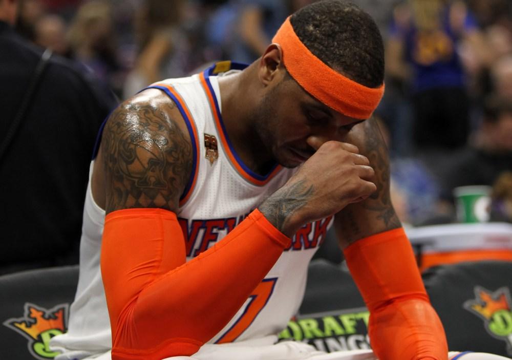 Dec 9, 2016; Sacramento, CA, USA; New York Knicks forward Carmelo Anthony (7) rests during the second quarter against the Sacramento Kings at Golden 1 Center. Mandatory Credit: Sergio Estrada-USA TODAY Sports