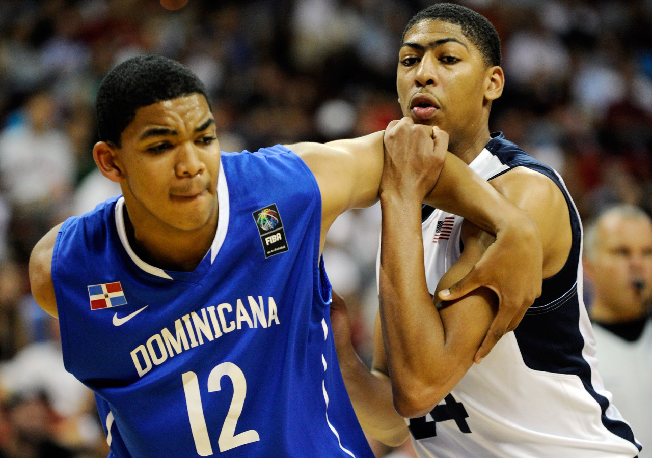 LAS VEGAS, NV - JULY 12: Karl Towns #12 (L) of the Dominican Republic and Anthony Davis #14 of the US Men's Senior National Team tussle for a rebound during a pre-Olympic exhibition game at Thomas & Mack Center on July 12, 2012 in Las Vegas, Nevada. Davis was a last minute replacement for injured Blake Griffin. (Photo by David Becker/Getty Images)
