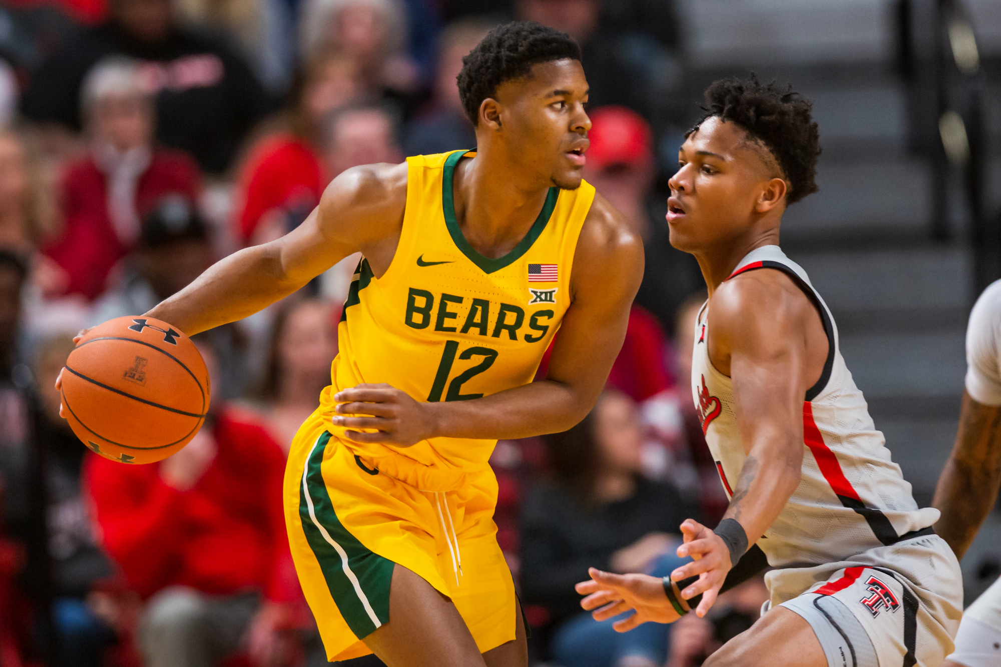 LUBBOCK, TEXAS - JANUARY 07: Guard Jared Butler #12 of the Baylor Bears handles the ball against guard Terrence Shannon #1 of the Texas Tech Red Raiders during the first half of the college basketball game on January 07, 2020 at United Supermarkets Arena in Lubbock, Texas.