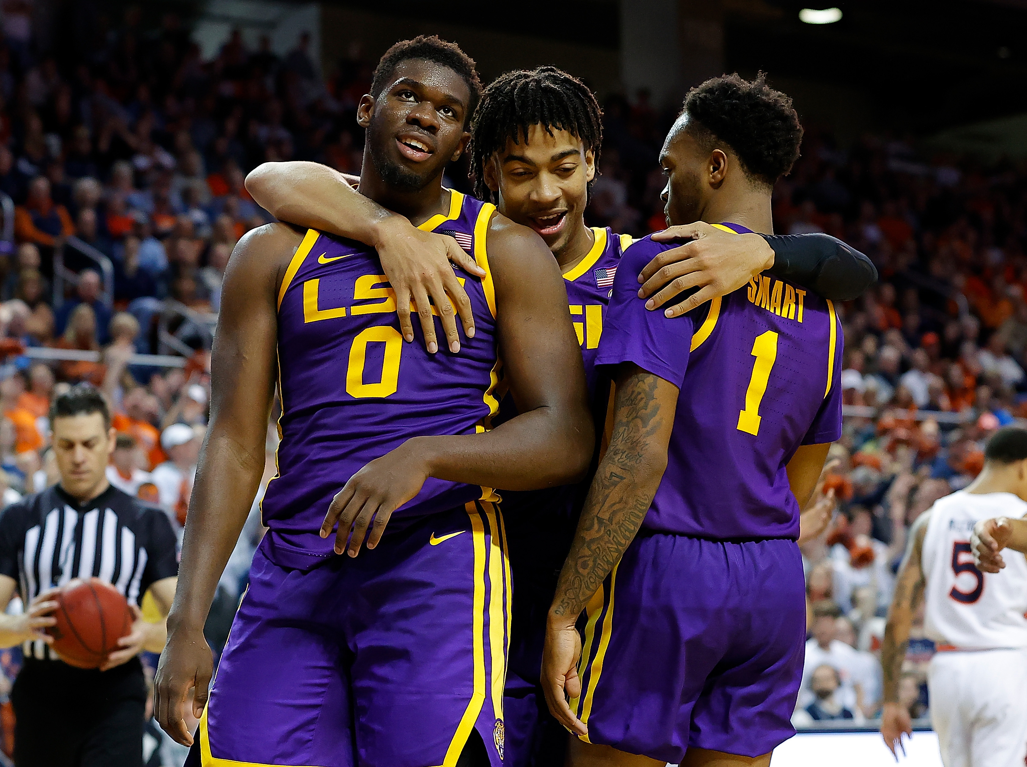 AUBURN, ALABAMA - FEBRUARY 08: Darius Days #0 of the LSU Tigers reacts after fouling out of the game against the Auburn Tigers with Trendon Watford #2 and Javonte Smart #1 at Auburn Arena on February 08, 2020 in Auburn, Alabama.