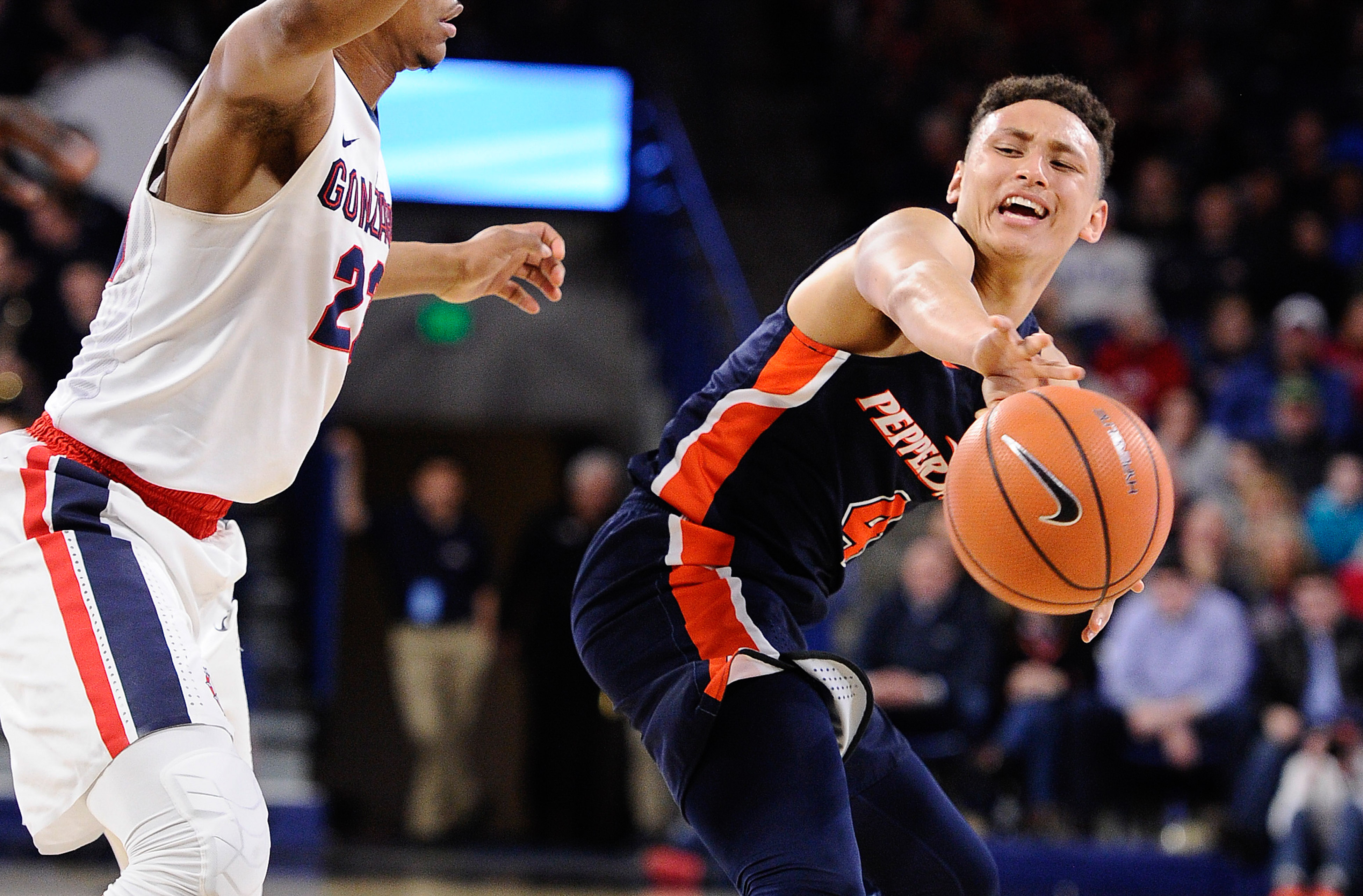 Feb 17, 2018; Spokane, WA, USA; Pepperdine Waves guard Colbey Ross (4) passes the basketball against Gonzaga Bulldogs guard Zach Norvell Jr. (23) during the second half at McCarthey Athletic Center. The Bulldogs won 81-76. Mandatory Credit: