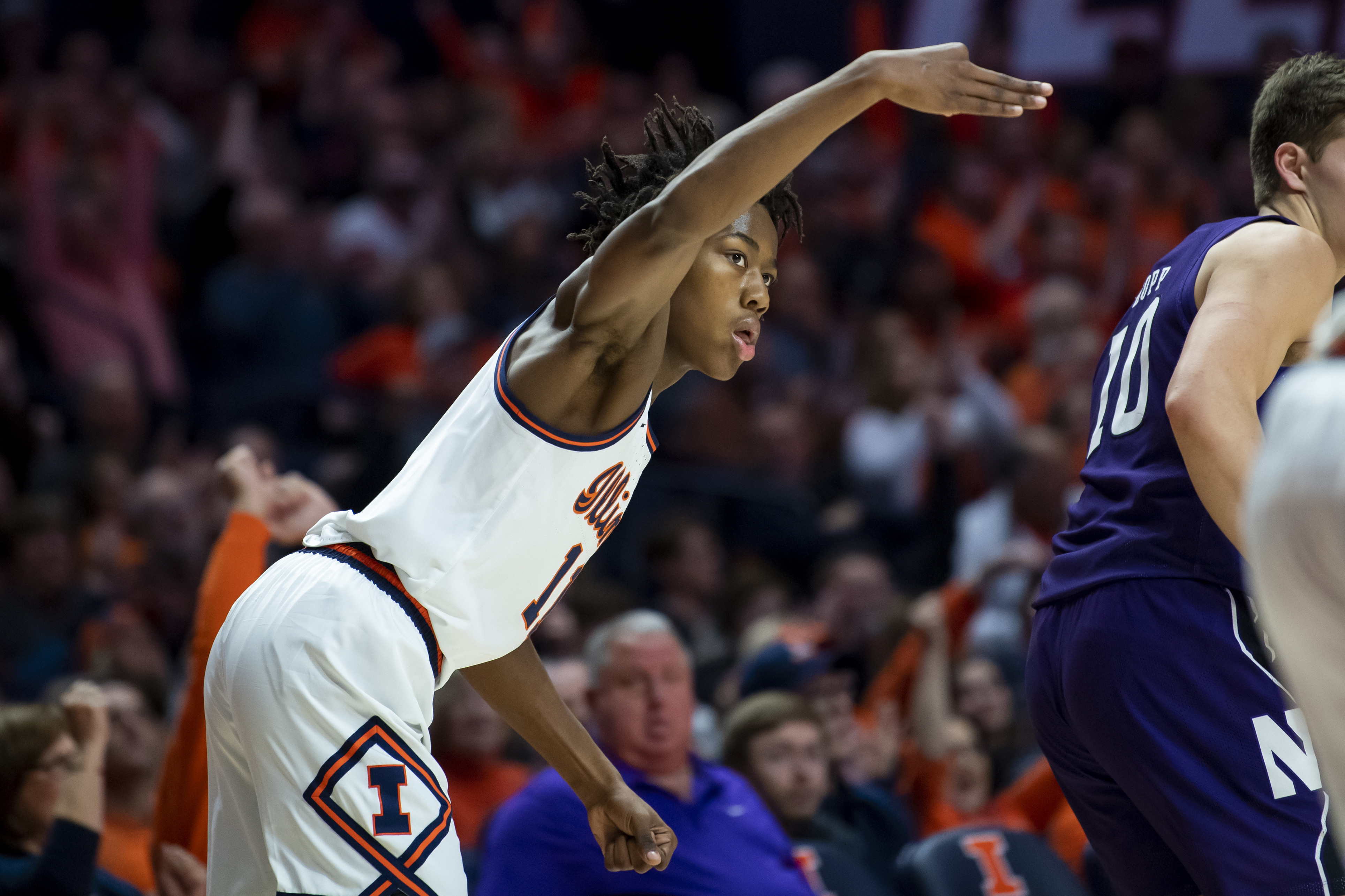 Jan 18, 2020; Champaign, Illinois, USA; Illinois Fighting Illini guard Ayo Dosunmu (11) reacts after his three point shot during the first half against the Northwestern Wildcats at State Farm Center.