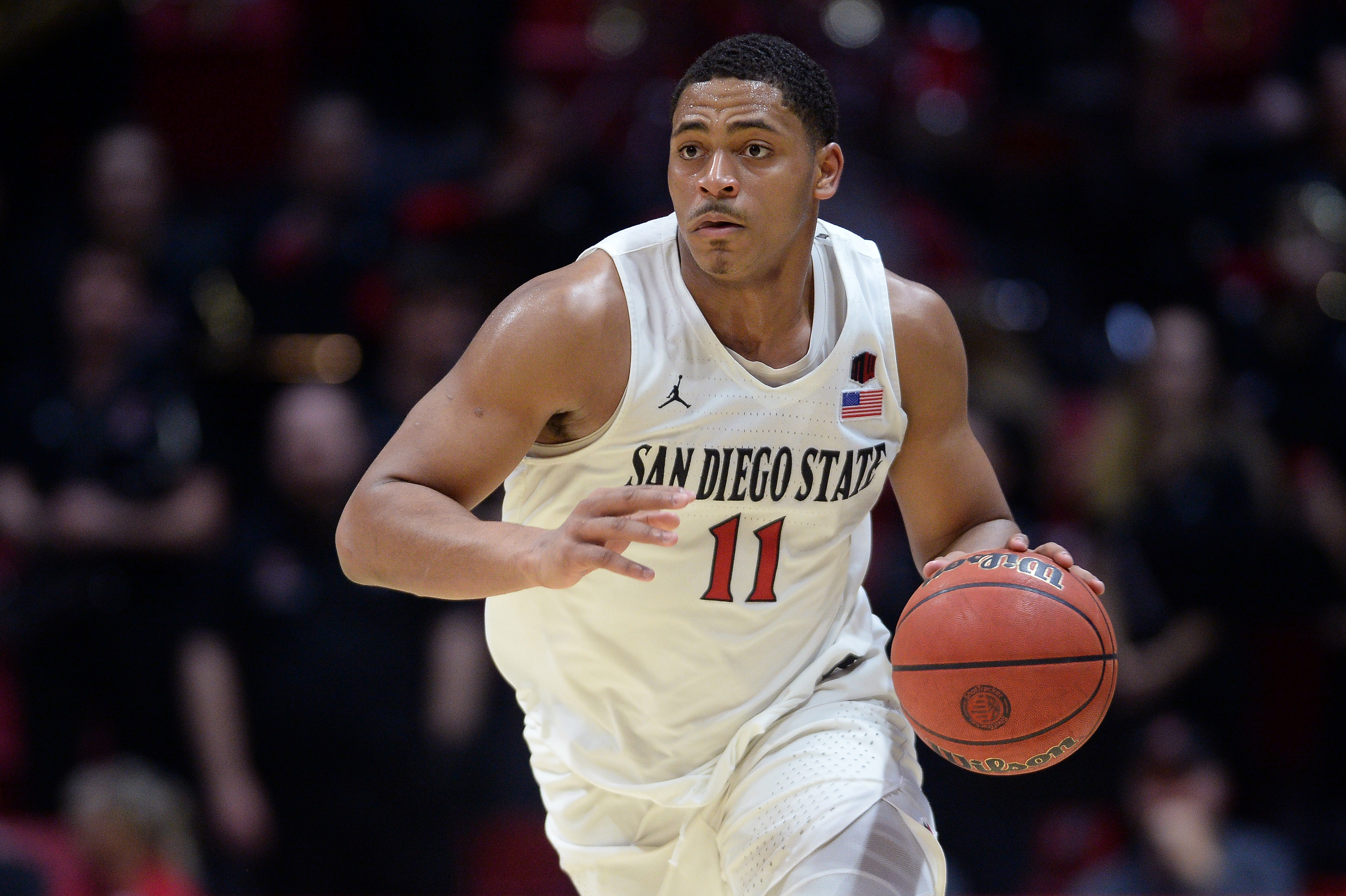 Feb 11, 2020; San Diego, California, USA; San Diego State Aztecs forward Matt Mitchell (11) dribbles during the second half against the New Mexico Lobos at Viejas Arena. Mandatory Credit:
