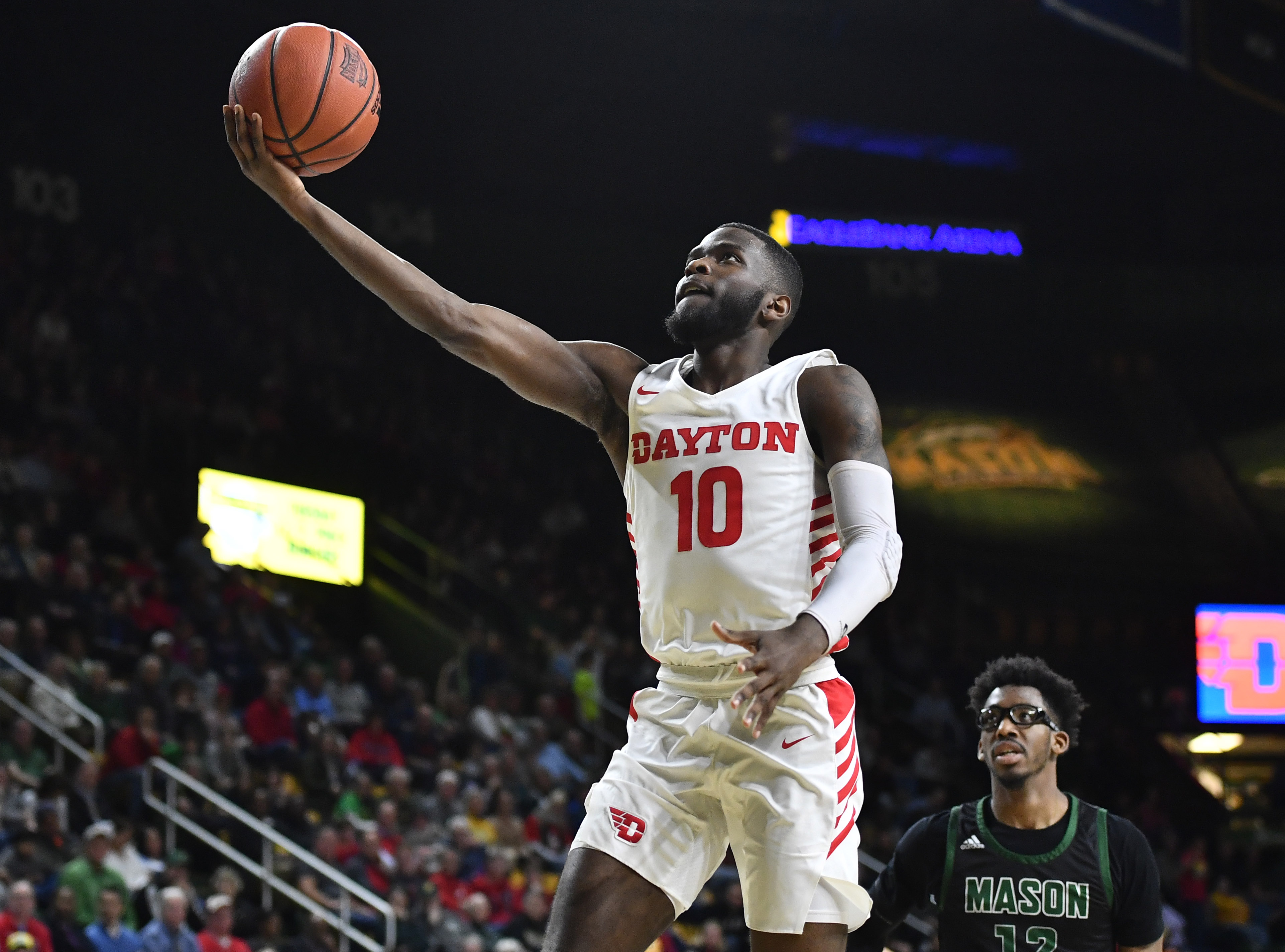 Feb 25, 2020; Fairfax, Virginia, USA; Dayton Flyers guard Jalen Crutcher (10) shoots as George Mason Patriots forward AJ Wilson (12) looks on during the first half at EagleBank Arena.